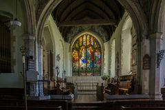 St Andrews Church Wickhambreaux. St Andrews Church Altar and Baptistry window in the Kent village of Wickhambreaux stock photography