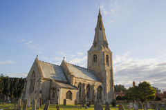 St Andrews Church, Leasingham, Sleaford, Lincolnshire. English village church surrounded by graves against a blue sky stock photos