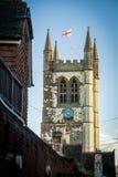 Parish church in Farnham in Surrey with England flag royalty free stock image