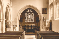 St Andrews Church Nave B HDR Sepia Tone. England, Chedworth - October 21, 2016: St Andrews Church Nave B HDR Sepia Tone royalty free stock photography