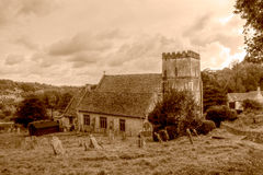 St Andrews Church South Facade HDR Sepia Tone. England, Chedworth - October 21, 2016: St Andrews Church South Facade HDR Sepia Tone stock photo