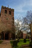 St. Andrews Church Tower, Penrith - Landmarks in Penrith, Cumbria. An exterior view of a red sandstone church building with tower in the Cumbrian town of stock images