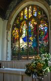 St Andrews Church Wickhambreaux. St Andrews Church 15th century Baptistry window and altar in the Kent village of  Wickhambreaux. England royalty free stock images