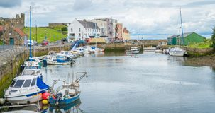 St. Andrews harbour, Scotland. St. Andrews is a seaside town northeast of Edinburgh, on Scotland's east coast. It`s known for its many golf courses, including Royalty Free Stock Image