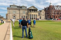 People playing golf at famous golf course St Andrews, Scotland. St Andrews, Scotland - May 21, 2018: People preparing playing golf at famous golf course St stock photos