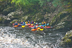 St Andrews Students on the River Findhorn. An image of a group of St Andrews University students preparing to kayak down the rapids on the River Findhorn at stock photo