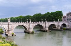 St. Angelo Bridge, built by the Roman Emporer Hadrian, is a pede. Strian bridge. Spanning the River Tiber., it was built in 134 A.D., with travertine marble Stock Image