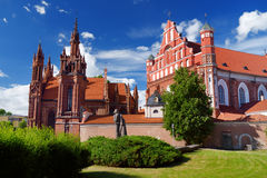 St. Anne`s Church and church of the Bernardine Monastery in Vilnius` Old Town, on the bank of the Vilnia River Stock Photo