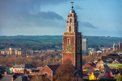 St. Anne's Church in Shandon, Cork. Aerial view of St. Anne's Church in Shandon, Cork, Ireland. Mountains and cloudy blue sky Royalty Free Stock Photos