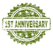 Grunge Textured 1ST ANNIVERSARY Stamp Seal. 1ST ANNIVERSARY stamp seal watermark with rubber print style. Green  rubber print of 1ST ANNIVERSARY tag with unclean Royalty Free Stock Photography