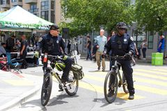 41st annual Carnaval Festival in San Francisco, California. San Francisco, CA - May 25, 2019: Police officers patrolling the 41st annual Carnaval Festival in the royalty free stock images