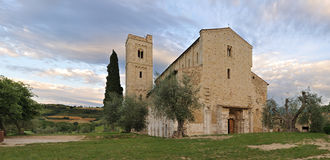 St. Antimo Abbey (Abbazia di Sant'Antimo). Siena, Tuscany, Italy  at sunset (composite stitched image Stock Photo