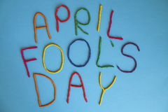 Funny font first april fools day written in plastecine of different colors. 1st April fools day text banner, colorful lettering made from plasticine on solid royalty free stock photos