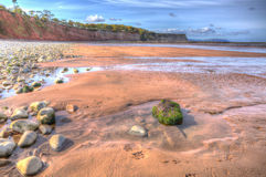 St Audries Bay beach Somerset England uk in colourful HDR. St Audries Bay Somerset England uk near Watchet in colourful HDR Stock Photos