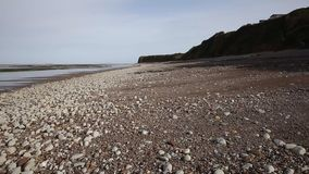 St Audries Bay beach Somerset pan view pebbles and shingle stock video