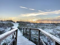 St. Augustine beach - Florida. Wooden walkway receding over grass sand dunes with blue sky and cloudscape background, St. Augustine, Florida stock image