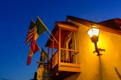 Top view of balcony and flags of seventeenth century mansion in Florida`s Historic Coast . St. Augustine, Florida. January 26 , 2019 . Top view of balcony and stock photography