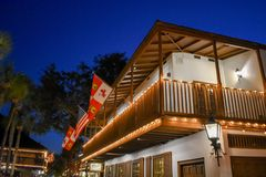 Top view of restaurant in seventeenth century house adn Flags at Old Town in Florida`s Historic Coast . St. Augustine, Florida. January 26 , 2019 . Top view of stock images