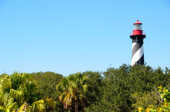 St Augustine lighthouse. Scenic view of St Augustine lighthouse with wood or forest in foreground; Florida, U.S.A Royalty Free Stock Photos