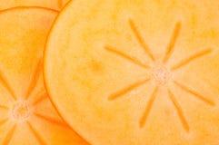 stäng upp cuted persimmonstycken Arkivfoto