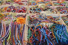 St AYGULF, VAR, PROVENCE, FRANCE, AUGUST 26 2016: Provencal market stall selling beads, armbands and other items in many multi col Royalty Free Stock Photo