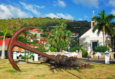 St Barth Anglican Church, Gustavia, palms, anchor. The island of St Barth, St. Barts, Saint-Barthélemy, French West Indies, French Antilles, Caribbean, sea stock image