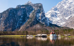St. Bartholoma church in Konigsee lake. View of St. Bartholoma church in Konigsee National Park in spring, Germany Stock Photos