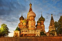St. Basil's Cathedral Under Summer Twilight Skies. MOSCOW, RUSSIA - Magnificent view from Vasileyvesky Spusk Basil's Slope on the Moscow`s most stock image