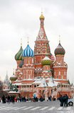 St. Basil Cathedral, Red Square, Moscow, Russia. People walking on the Red Square at St. Basil Cathedral in winter. Police car and three policemen standing at Royalty Free Stock Photography