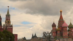 St. Basil Cathedral and Spasskaya Tower against the background of clouds. Moscow Kremlin stock video