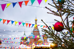 St. Basil`s Cathedral on the background of the Christmas Fair. R Royalty Free Stock Photo