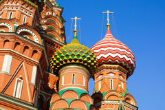 St. Basil's Cathedral.fragment. Moscow. Two domes of the temple St. Basil's Cathedral.against the blue sky Stock Images