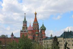 St. Basil`s Cathedral and the Kremlin Spasskaya tower on red square in Moscow Russia stock image