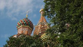 St Basil`s Cathedral in Moscow. Colorful domes and other fragments of St Basil`s Cathedral on Red Square near Kremlin. It`s the major landmark in Moscow, Russia stock footage