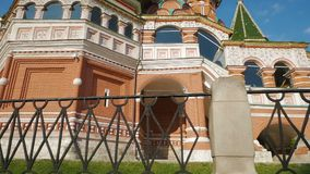 St Basil`s Cathedral in Moscow. Low angle panning shot of lower part of St Basil`s Cathedral and its wall paintings, popular tourist destination in Moscow stock video footage