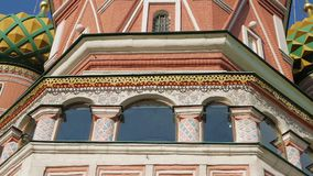 St Basil`s Cathedral in Moscow. Panning shot of colorful domes and other fragments of St Basil`s Cathedral on Red Square near Kremlin. It`s the major landmark in stock video