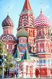 St. Basil`s Cathedral in Moscow on Red Square. On a summer sunny day on light blue cloud background Royalty Free Stock Photo