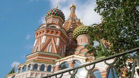 St Basil`s Cathedral in Moscow. Tilt up shot of St Basil`s Cathedral and its colorful domes on Red Square near Kremlin. It is popular tourist spot in Moscow stock video