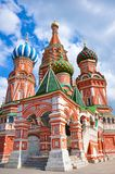 St. Basil`s Cathedral - an Orthodox church on Red Square in Moscow, the oldest architectural monument. Multicolored colorful domes. A cathedral made of red Stock Image