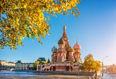 St. Basil`s Cathedral on Red Square and autumn yellow leaves. St. Basil`s Cathedral on Red Square in Moscow in the frame of autumn yellow leaves on trees in the stock images