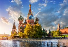 St. Basil`s Cathedral on Red Square in Moscow. In the light of the morning autumn sun and clouds in the blue sky Royalty Free Stock Photography