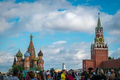 St. Basil`s Cathedral and Spasskaya Bashnya at Red Square in Moscow, Russia. stock photo