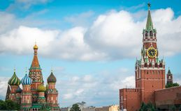 St. Basil`s Cathedral and Spasskaya Bashnya at Red Square in Moscow, Russia. View of St. Basil`s Cathedral and Spasskaya Bashnya in Red Square near the Kremlin royalty free stock photography