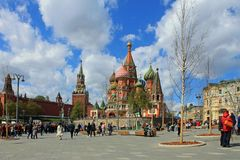St. Basil`s Cathedral and the Kremlin Spasskaya tower on red square in Moscow Russia royalty free stock image