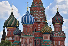 St. Basils Domes. Colorful close-up photograph of the Domes of St Basils Church in Moscow located on Red Square Stock Photos