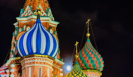 St. Basilio Cathedral. Night view of the colorful domes of St. Basilio Cathedral in Moscow with the moon stock photos