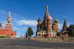 St. Basils cathedral and Spasskaya Tower on Red Square in Moscow, Russia. Summer view of Red Square in Moscow, Russia royalty free stock images