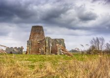 St Benet`s Abbey gatehouse and mill on the Norfolk Broads during a winter storm. stock photos