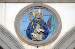 St. Bonaventure, Ospedale di San Paolo in Florence. St. Bonaventure, glazed terracotta tondo by Andrea della Robbia, located between two arches of the old stock images