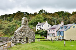 St. Brynach's Church and cottages, Cwm-yr-Eglwys Royalty Free Stock Image